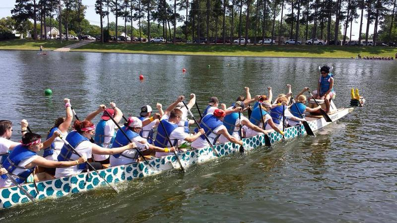 Twenty rowers and one drummer make up the dragon boat team.