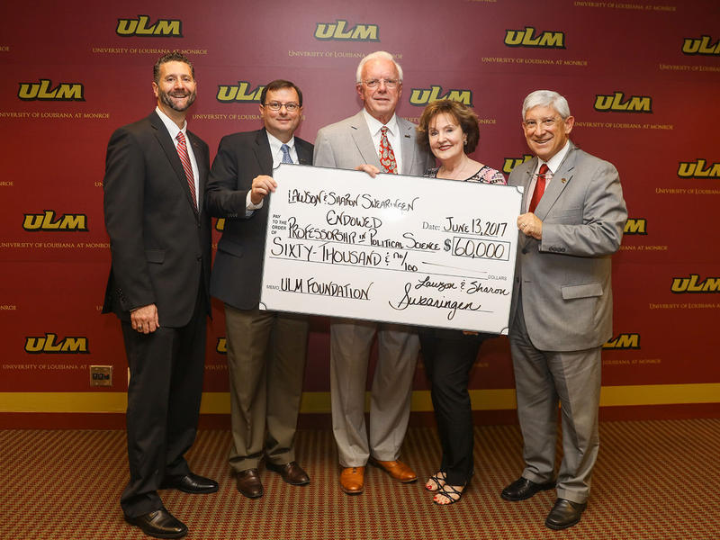 Dr. Lawson and Mrs. Sharon Swearingen present a $60,000 donation to ULM.