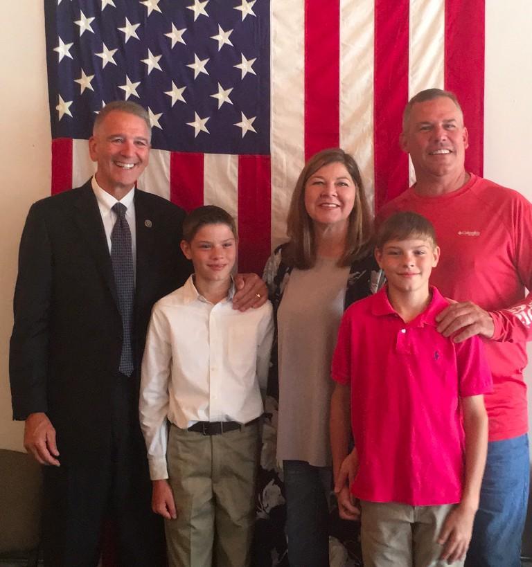 Congressman Ralph Abraham posses with Tanner Bentz (white shirt) and the Bentz family, Tiffanie, Nolan and Randy.