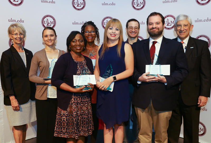 Six faculty and staff at the University of Louisiana Monroe were recognized Thursday with the prestigious ULM Foundation Award. Presenting the awards were Foundation Executive Director Susan Chappell, left, and ULM President Nick J. Bruno, right. Winners