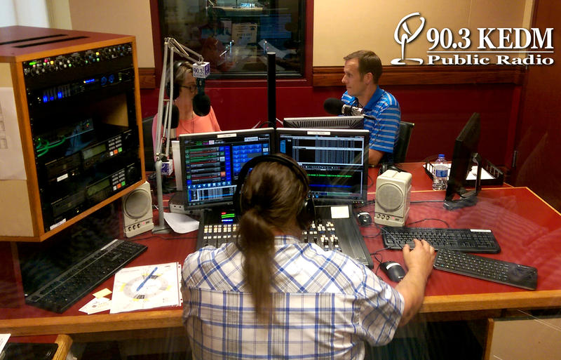 Ann Bloxom Smith and Kris Kelley from Friends of Black Bayou raise money on the air while Kenneth Sanders produces.