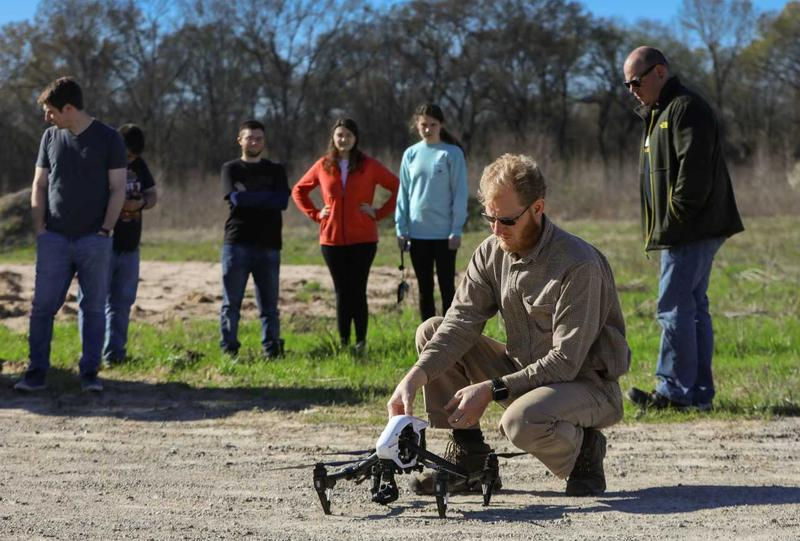 Dr. Chenoweth prepares a drone for an inspection flight.