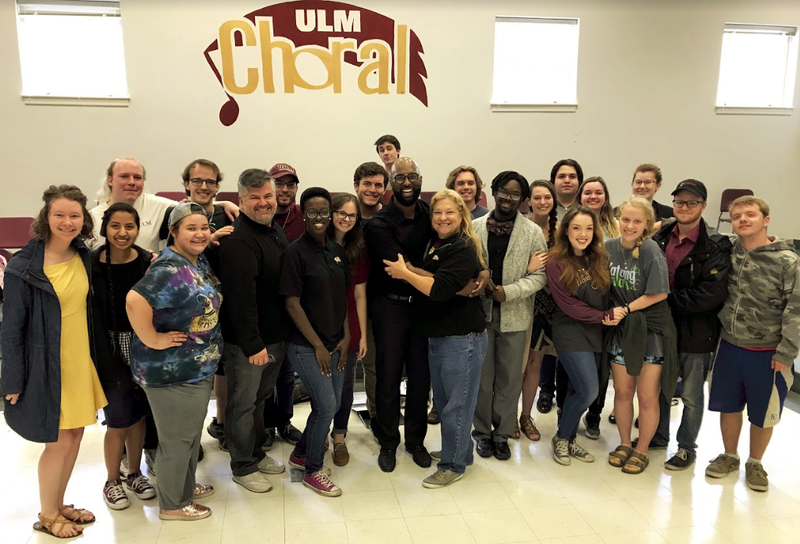 Dr. Brandon Boyd and Dr. Deborah Chandler (center) with the ULM Chamber Choir after a rehearsal.