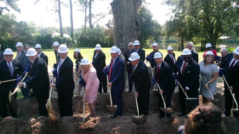 Golden shovels turn the soil to get construction underway