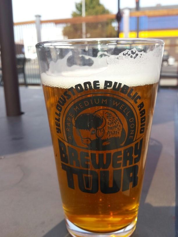 An ice cold beer in YPR's Brewery Tour pint glass at Angry Hanks in Billings!