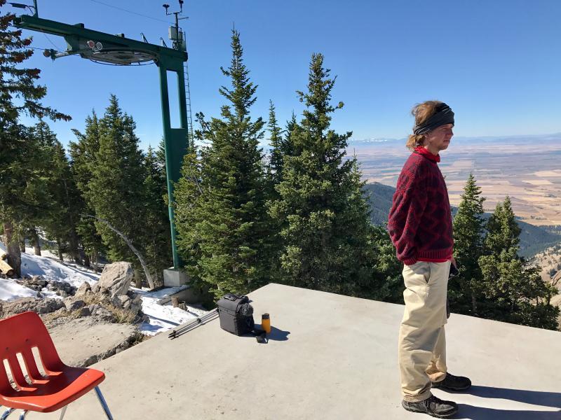 Bret Davis stands atop a concrete helipad that serves as his office at Bridger Bowl near Bozeman.