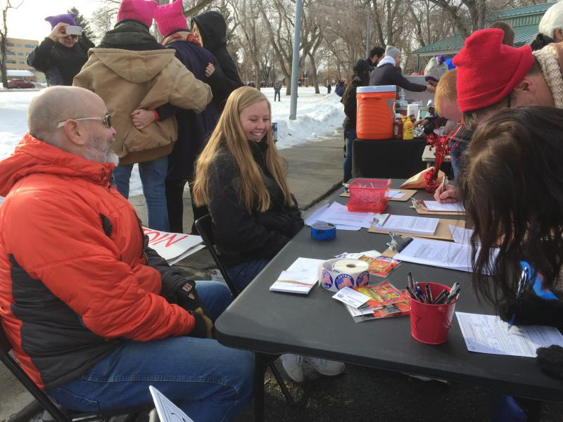 The League of Women Voters set up a table to register voters