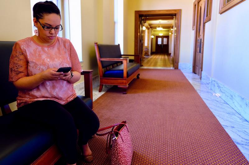 Briana Lamb posts a status update on Facebook at the state capitol in Helena, Montana.