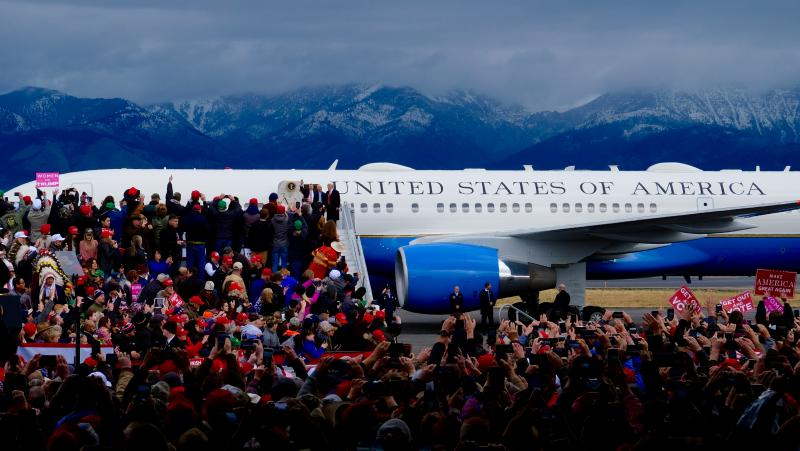 President Donald Trump coming down from Air Force One as the crowd watches.