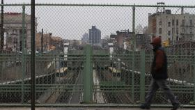 Park Avenue in the South Bronx - man walks by sunken train tracks.