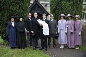 Shown from left to right: Penelope Wilton as Isobel Crawley, Maggie Smith as Violet, Dowager Countess, Dan Stevens as Matthew Crawley, Hugh Bonneville as Lord Grantham, Allen Leech as Tom Branson, Ruairi Conaghan as Kieran Branson, Michelle Dockery as Lady Mary Crawley, Elizabeth McGovern as Cora Countess of Grantham and Laura Carmichael as Lady Edith Crawley.