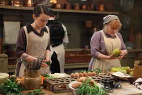 Shown left to right: Sophie McShera as Daisy, Lesley Nicol as Mrs. Patmore