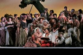 "Anna Netrebko (center) as Adina in in Donizetti's ""L'Elisir d'Amore"