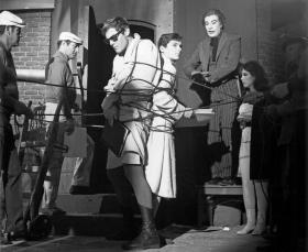 (L-R) Adam West, Burt Ward, and Cesar Romero rehearse a scene in the 1960s Batman television series.