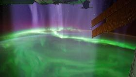 Visualization of charged particles streaming down onto the atmosphere, creating a stunning aurora as viewed from the International Space Station.