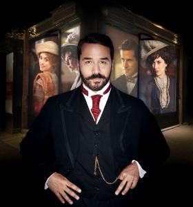 Jeremy Piven as Harry Gordon Selfridge (foreground). Shown in background (l-r): Zoe Tapper as Ellen Love, Frances O'Connor as Rose Selfridge, Gregory Fitoussi as Henri Leclair and Katherine Kelly as Lady Mae.