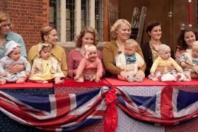 Shown: Supporting actors as the street party