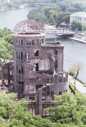 """The Hiroshima Dome in Hiroshima, Japan, which stood virtually at the epicenter of the atomic-bomb explosion on August 6, 1945. The atomic bomb, nicknamed """"Little Boy,"""" killed 140,000 either instantly or later as a result of injuries or radiation poisoning. Photo credit: Diane Love. © Whistling Communications."""
