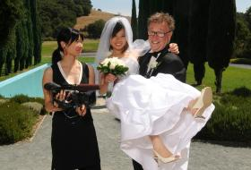 Steven & Sandy on their wedding day with the documentary's director, Debbie Lum.