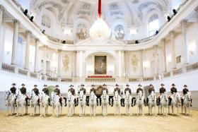 Hear the story of the world-famous Lipizzaner stallions, from their origins in ancient times to the almost unknown drama of their rescue in 1945. Pictured: Riders at the Spanish Riding School, Vienna, Austria.