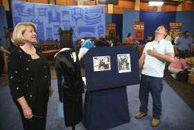 "At ANTIQUES ROADSHOW in Palm Springs, California, this guest (right) brings in the ultimate little black dress worn by Marilyn Monroe in the classic 1959 comedy ""Some Like it Hot"" estimated to be worth a sizzling $150,000 to $250,00."