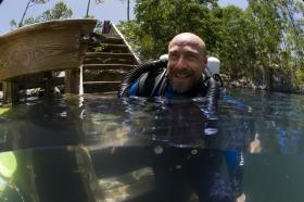 Anthropologist Kenny Broad is all smiles preparing for dive.