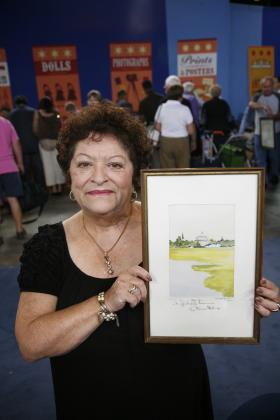 At ANTIQUES ROADSHOW in Hartford, Connecticut, this guest wows appraiser Kathleen Guzman with a signed watercolor by Katharine Hepburn. A gift to the guest from Hepburn when she performed at the American Shakespeare Theater in Stratford, Connecticut, the charming painting's creator and original signature boost its value to $15,000 to $20,000.