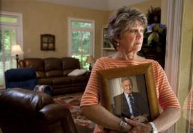 "Cheryl Morgan (pictured), whose story is featured in ""Life and Death in Assisted Living,"" holds a photo of her late father, who had dementia. He died after drinking unsecured toxic dishwashing liquid at a Georgia assisted living facility."