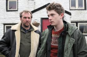 Raff (JOSH BOLT) and Robbie (DEAN ANDREWS) outside Far Slack Farm