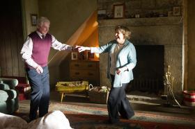 Alan (DEREK JACOBI) and Celia (ANNE REID) are jiving in the lounge at Far Slack Farm