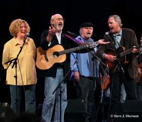"Celebrate the legacy of Woody Guthrie's singer-songwriter ""children"" in a rousing live concert featuring (l-r) Holly Near, Noel Paul Stookey, Tom Paxton and Tom Chapin."