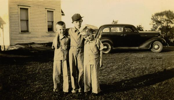 Author and historian Jerry Apps tells the story of growing up in the rural farming community of Wild Rose, Wisconsin, in the 1930s and 1940s. Pictured: Apps (center) with twin brothers Darrel and Donald, circa 1944.