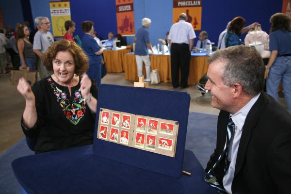At the ANTIQUES ROADSHOW event in Wichita, Kansas, this lucky guest (left) is certainly surprised when told rare hall-of-famers are among her collection of 1914 and 1915 Cracker Jack baseball cards. Appraiser Brian Marren points out Joe Jackson, Ty Cobb, Honus Wagner and an extremely rare 1914 Christy Mathewson card and estimates the entire collection could score $30,000 to $40,000.