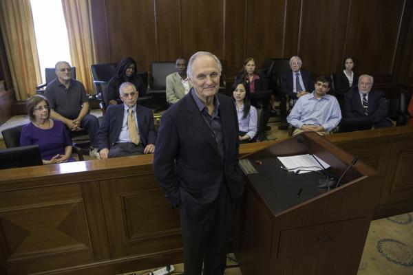 Alan poses in front of the jury.