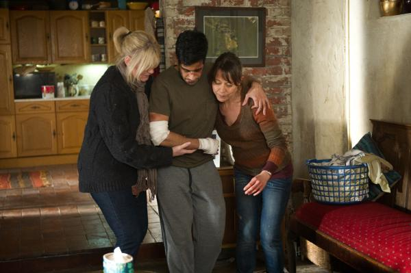 Caroline (SARAH LANCASHIRE) and Gillian (NICOLA WALKER) try to hide Paul up the stairs.