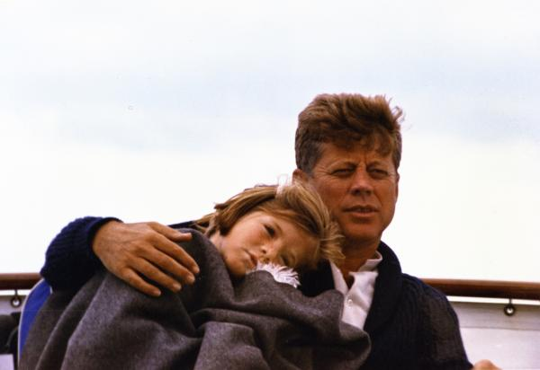 President Kennedy and his daughter Caroline on a yacht during a weekend in Hyannis Port.