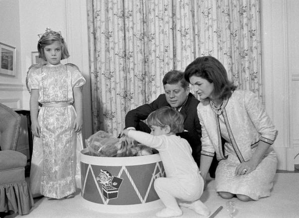 Taken November 27, 1962. Caroline Kennedy's 5th Birthday in the White House nursery. Pictured (from left) Caroline, John Jr., President Kennedy, Mrs. Kennedy.