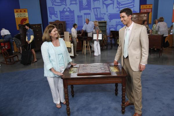 "Andrew Brunk (right) appraises a New Orleans Chess Table, ca. 1870, that endured through Hurricane Katrina and is valued at $3,000-$5,000. in the ANTIQUES ROADSHOW special ""Survivors."""