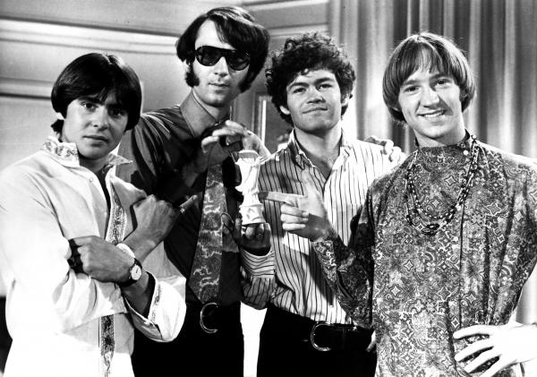 """The late Davy Jones, left, is seen with fellow members of iconic pop-rock group The Monkees. Jones sings several Monkees classics, including """"Daydream Believer,"""" in THE BEST OF THE 60s."""