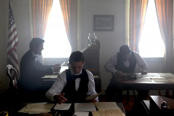 Lincoln and telegraph operators in the war time telegraph office.