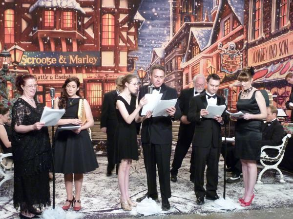 "Cast members performing KTWU's ""A Christmas Carol"" a live radio-play drama of the Dicken's classic."