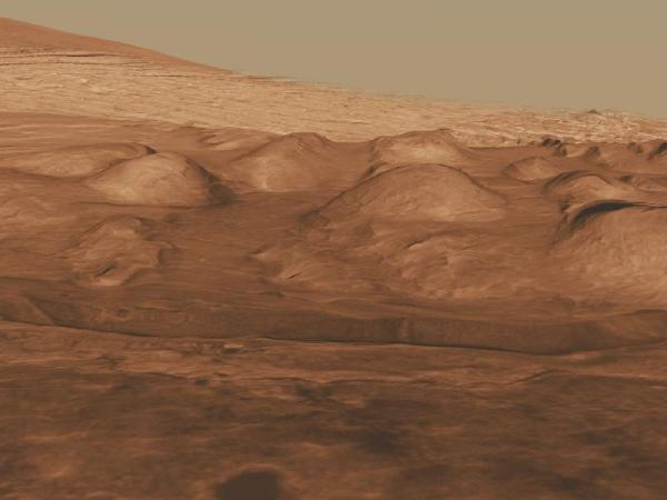 This oblique view of the lower mound in Gale crater shows layers of rock that preserve a record of environments on Mars. Here, orbiting instruments have detected signatures of both clay minerals and sulfate salts, with more clay minerals apparent in the foreground of this image and fewer in higher layers. This change in mineralogy may reflect a change in the ancient environment in Gale Crater.