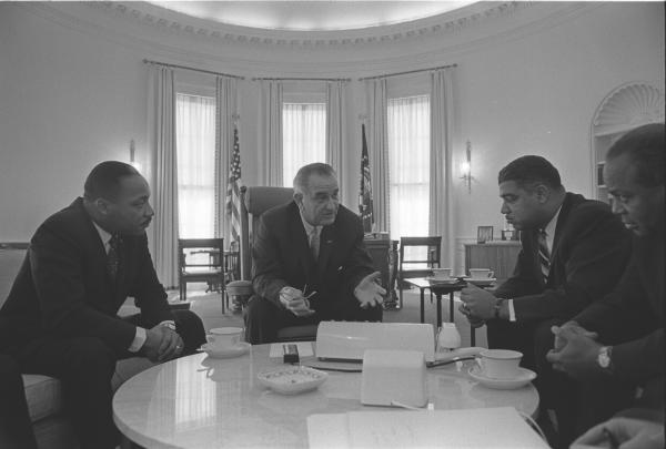 President Lyndon B. Johnson meets with Civil Rights leaders. L-R: Martin Luther King, Jr., President Lyndon B. Johnson, Whitney Young, James Farmer. January 18, 1964.