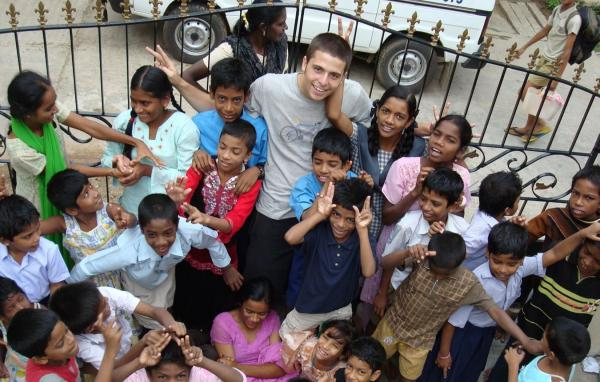 Rocky and the kids on his first trip to India.
