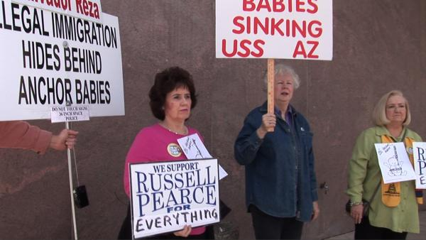 Supporters of tough Arizona immigration laws outside the state capitol.