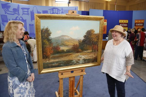 Nan Chisholm (left) appraises a Porfirio Salinas oil painting, ca. 1935 for $75,000 in Baton Rouge, Louisiana.