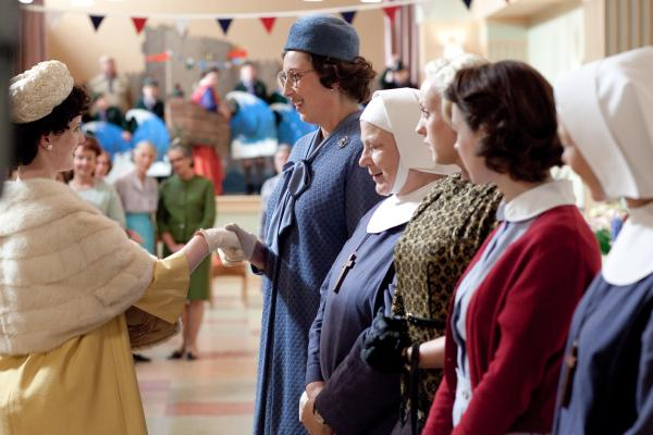 Chummy (Miranda Hart), Sister Evangelina (Pam Ferris), Trixie (Helen George) and Jenny Lee (Jessica Raine) greeting Princess Margaret (SA)