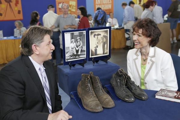 Philip Weiss (left) appraises Buddy Ebsen's performance shoes for $20,000 in Anaheim, California