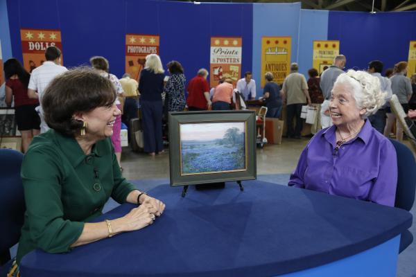 Debra J. Force (left) appraises a 1920 Julian Onderdonk oil painting for $125,000 in Kansas City, Missouri.