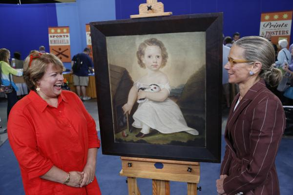 Nancy Druckman (right) appraises a Folk Art portrait of a child, ca. 1825 , for $12,000 to $18,000 in Richmond, Virginia.
